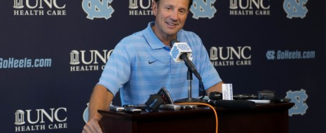 """By Clifton Barnes With a more experienced offensive line, UNC coach Larry Fedora expects quarterback Marquis Williams to take on less of the load and distribute the ball better. Last season the Tar Heels had just one returning starter on the offensive line and as a result Williams, a big and physical quarterback, called his own number many times to evade the defense. All that running got him bruised and battered and led to fewer of the other skill players getting the ball in their hands. """"The reason he did that lack of experience on the offensive line… I think […]"""